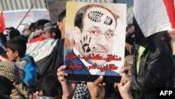 Nga protestat kundër kryeministrit Nuri al-Maliki...