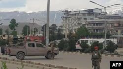 Afghan security personnel arrive at the scene of an attack near the Marshal Fahim Military Academy in Kabul on May 30.