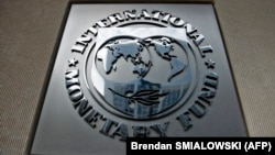 U.S. -- A logo outside the headquarters of the International Monetary Fund in Washington, DC, June 30, 2015.