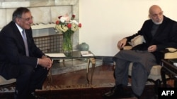 Afghan President Hamid Karzai (right) meets with U.S. Defense Secretary Leon Panetta in Kabul on March 15.