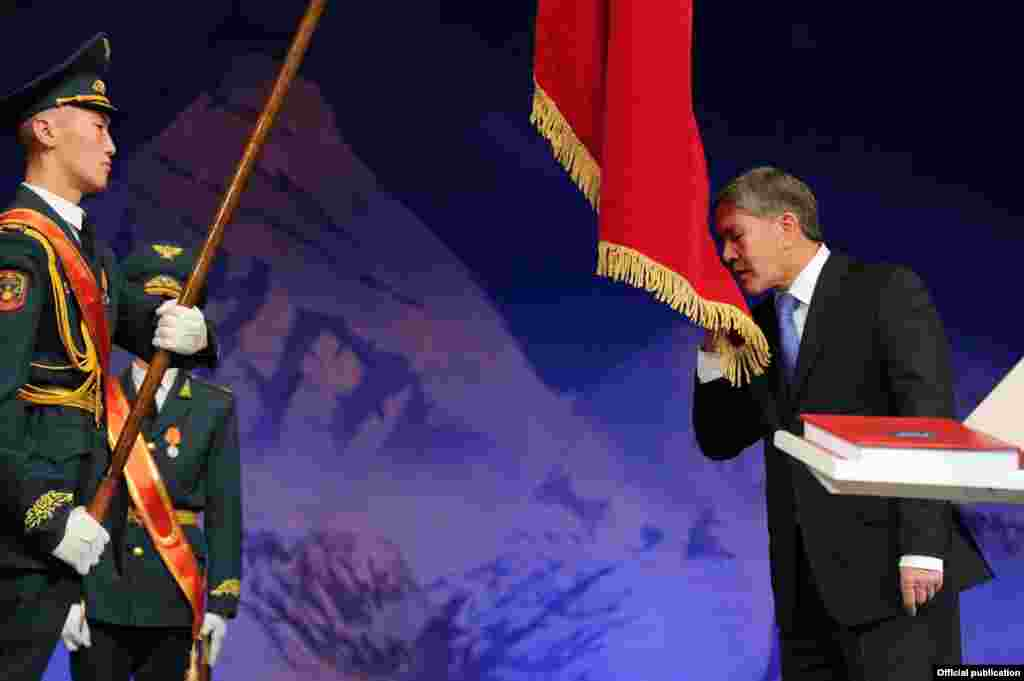 Almazbek Atambaev kisses the Kyrgyz flag at a ceremony to inaugurate him as that country's president on December 1.