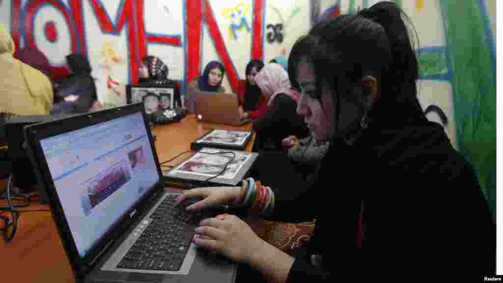 Afghan girls work at the first Internet cafe for women in Kabul. (Reuters/Mohammad Ismail)