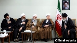 Ex-President Ali Akbar Hashemi Rafsanjani (second from right) at a meeting in 2011 with Supreme Leader Ali Khamenei (right) and members of Iran's powerful Guardians Council.