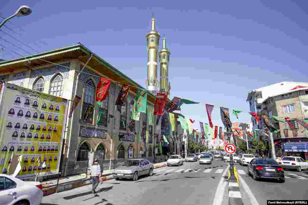 Banners with the names of Shia imams hang above the street outside the Abrava Mosque in Iranian Astara during the month of Muharram -- the first month of the year on the Islamic calendar, and one of the four sacred months.