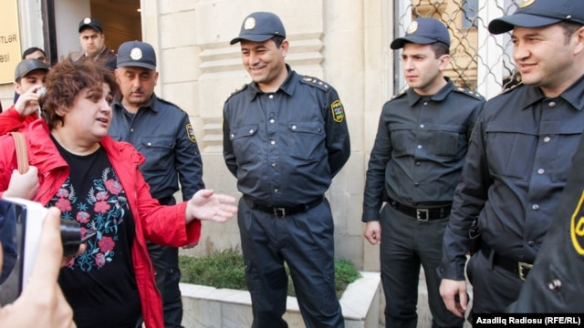 The Freedom House report mentioned the detention of investigative journalist and RFE/RL contributor Khadija Ismayilova (left) in its criticism of Azerbaijan's media space. (file photo)