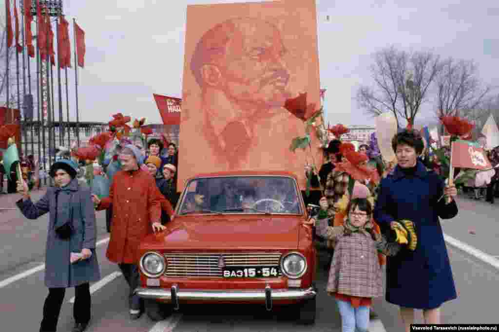 Lenin's image being paraded on a newly minted Lada in Tolyatti. The industrial town was named after the leader of the Italian Communist Party after the Lada manufacturing plant was established in the 1960s as a partnership between Russia and Italy.