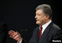 Президент України Петро Порошенко під час прес-конференції у Києві. 14 січня 2016 року