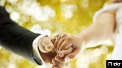 Couple holding hands marriage