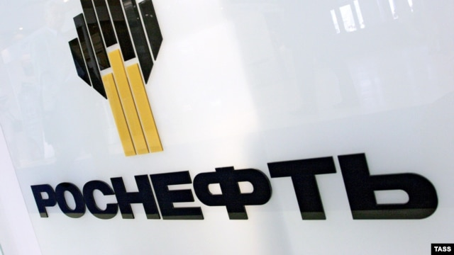 """A statement from Rosneft said the company was """"deeply shocked"""" by the """"Kommersant"""" article and might sue the newspaper."""