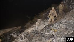 Поисковая операция на месте крушения пассажирского самолета авиакомпании «Пакистанские международные авиалинии» в пакистанской провинции Хайбер-Пахтунхва. 7 декабря 2016 года.