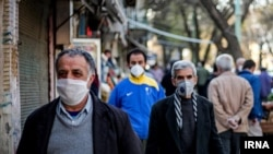 People wearing masks on the streets of Tehran. July 2020.