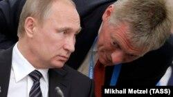 Russian President Vladimir Putin's spokesman, Dmitry Peskov (right), has been busy this week issuing nondenials on his boss's behalf. (file photo)