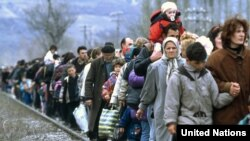 Kosovar refugees flee across the border into Macedonia in March 1999.
