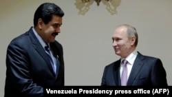 Russian President Vladimir Putin (right) and his Venezuelan counterpart Nicolas Maduro at the Gas Exporting Countries Forum in Tehran in 2015.