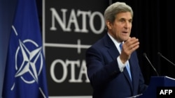 """U.S. Secretary of State John Kerry at NATO headquarters in Brussels on December 6: """"The change of the administration will not change the unwavering commitment of the U.S. to...our NATO obligations."""""""