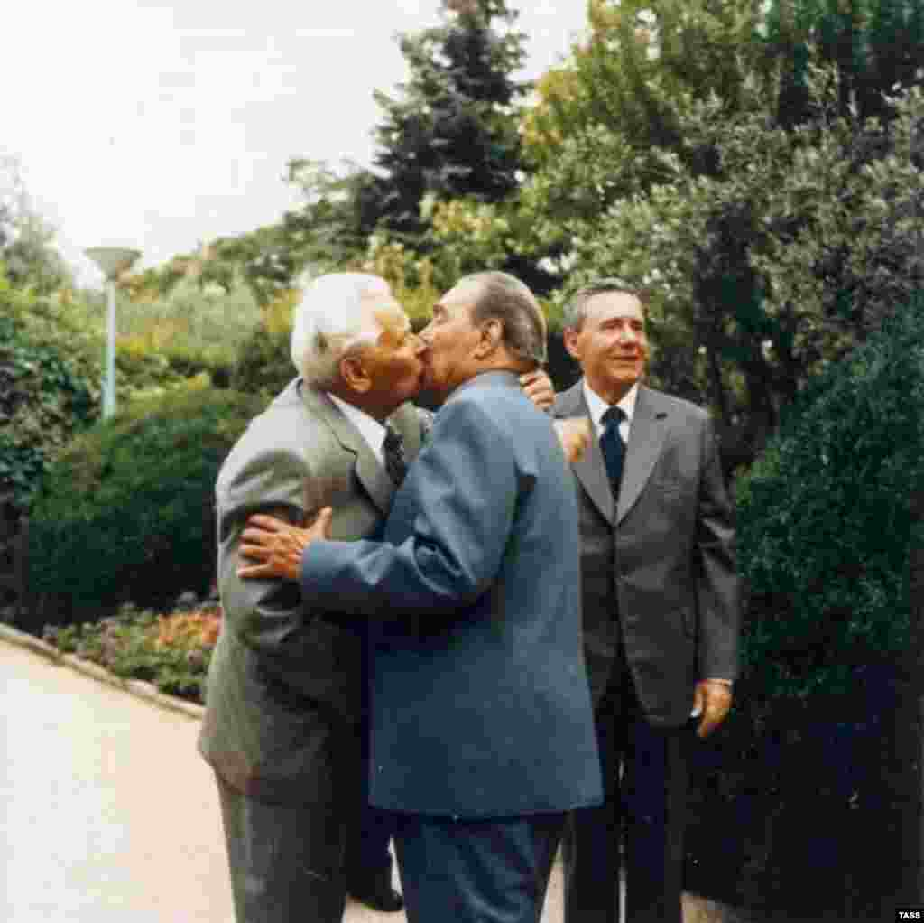And no one kissed like Soviet leader Leonid Brezhnev, pictured (center) greeting communist heart-throb Konstantin Chernenko in Crimea in 1980.