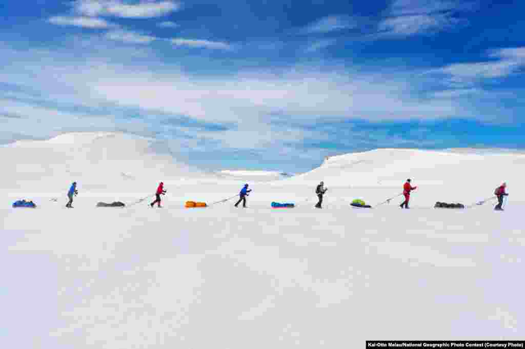 VIEWER'S CHOICE FOR PEOPLE: Expedition Amundsen (Hardangervidda, Norway) -- A race that follows in the path of the famous explorer Roald Amundsen brings the contestants to the Hardangervidda Mountain Plateu, Norway. One-hundred kilometers across the plateau, the exact same route Amundsen used to prepare for his South Pole expedition in 1911 is still used by explorers today. Amundsen did not manage to cross the plateau and had to turn back because of bad weather. He allegedly said that the attempt to cross Hardangervidda was just as dangerous and hard as the conquering of the South Pole. The group in the picture used the race as preparations for an attempt to cross Greenland. (Caption by photographer Kai-Otto Melau)