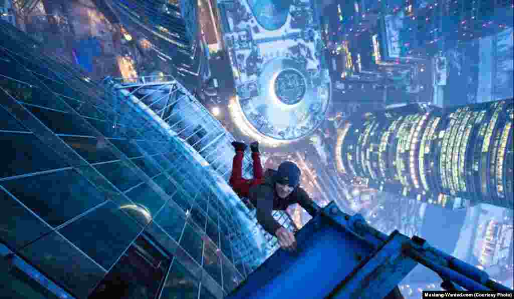 Hanging from a girder atop a Moscow high-rise