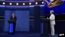 Republican presidential nominee Donald Trump (left) and Democratic presidential nominee Hillary Clinton arrive on stage for the third and final presidential debate at the University of Nevada in Las Vegas on October 19.