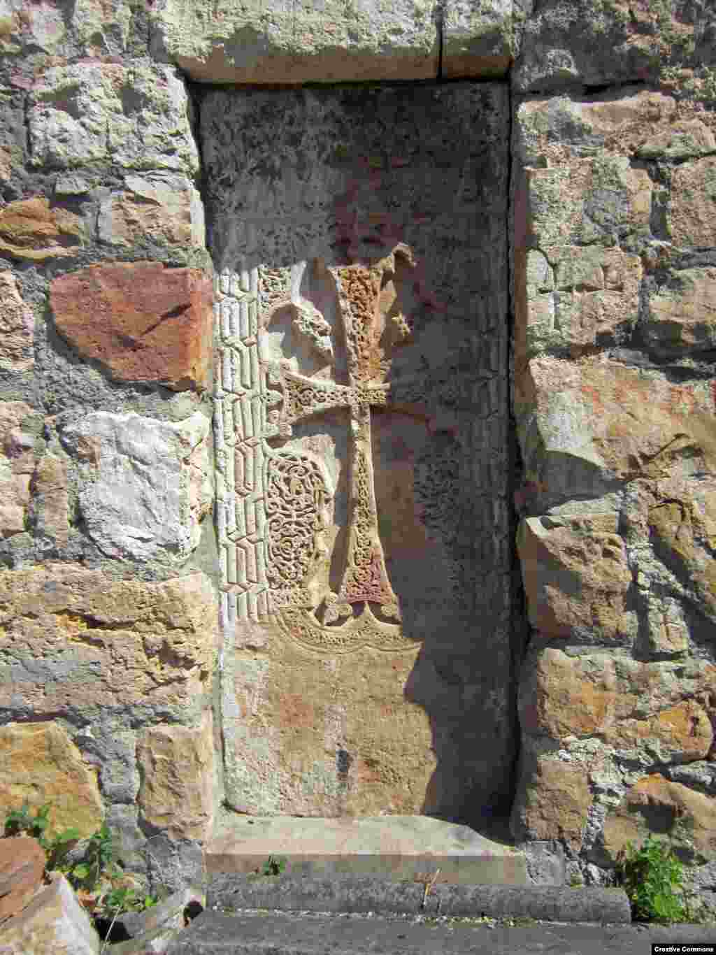 A detail of a carved stone cross (visible just right of center in the previous photo) near the entrance to Gtichavank. The monastery was completed in 1248.