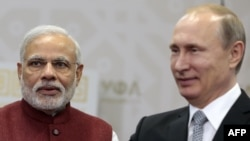 Russian President Vladimir Putin (R) and Indian Prime Minister Narenda Modi arrive for their meeting in Ufa on July 8.