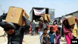 Гуманитардык жардам алган ирактык качкындар
