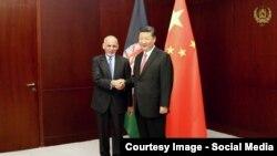 Ооган президенти Ашраф Гани Кытай лидери Си Цзиньпин менен жолуккан учур. 9-июнь, 2017-жыл.