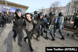 Police haul away protesters at demonstrations in Moscow on March 26.