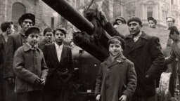 Hungary -- Fighters stand next to a Soviet tank on the streets of Budapest at the time of the uprising against the Soviet-supported Hungarian communist regime in 1956