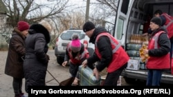 Ukraine -- Red Cross volunteers distribute humanitarian aid among Berdianske village inhabitants. Donbas, 28Nov2016