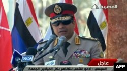 "A TV grab shows army chief General Abdel Fattah al-Sisi giving a live broadcast on July 24 calling for public rallies this week to give him a mandate to fight ""terrorism and violence."""