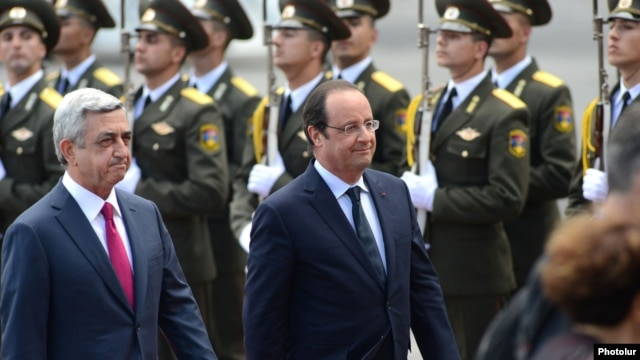 Armenia - French President Francois Hollande (R) is greeted by his Armenian counterpart Serzh Sarkisian at the start of an official visit to Yerevan, 12May2014.