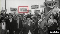 Скриншот последнего немого фильма Чарли Чаплина «Новые времена» (1936). Демонстрант в кадре держит плакат «Свобода», написанный на беларусском языке