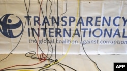 Germany -- Microphone cables dangle over a logo of Transparency International (TI) during a press conference in Berlin, 23Sep2008