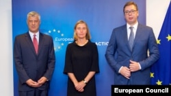 EU foreign policy chief Federica Mogherini (center), is hosting the talks between Kosovo's President Hashim Thaci (left) and his Serbian counterpart, Aleksandar Vucic (right). (file photo)