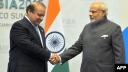 Indian Prime Minister Narendra Modi, right, greets Pakistani Prime Minister Nawaz Sharif ahead of a meeting on the sidelines of the BRICS summit in Ufa on July 10.
