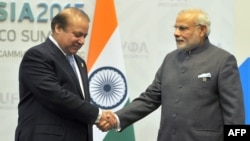 Indian Prime Minister Narendra Modi (R) greets Pakistani Prime Minister Nawaz Sharif in Ufa, Russia, July.