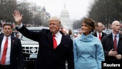 U.S. President Donald Trump and first lady Melania Trump walk during the inaugural parade from the U.S. Capitol in Washington last month.