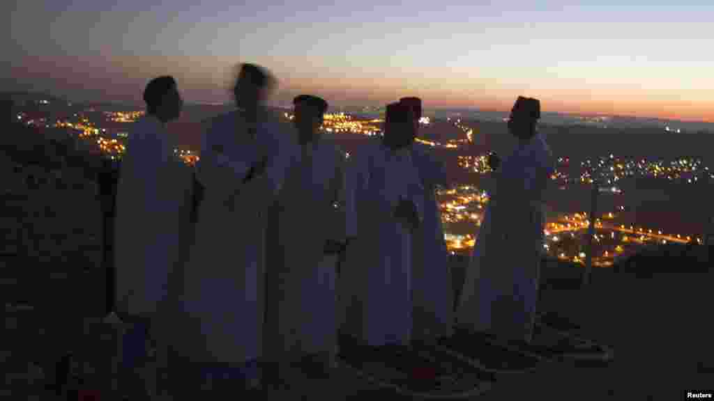 OCTOBER 29, 2012 -- Members of the Samaritan community take part in a traditional pilgrimage marking the holiday of Sukkot, or Feast of Tabernacles, atop Mount Gerizim near the West Bank city of Nablus. (Reuters/Baz Ratner)