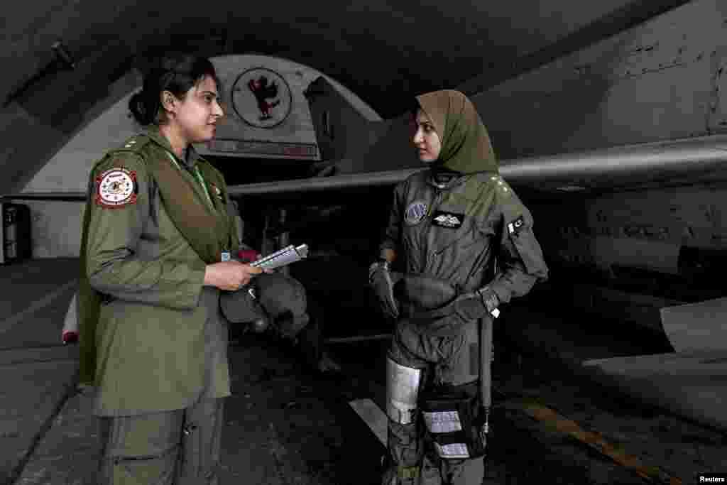 Ayesha Farooqtalks with avionics engineer Anam Hassan at Mushaf base in Sargodha