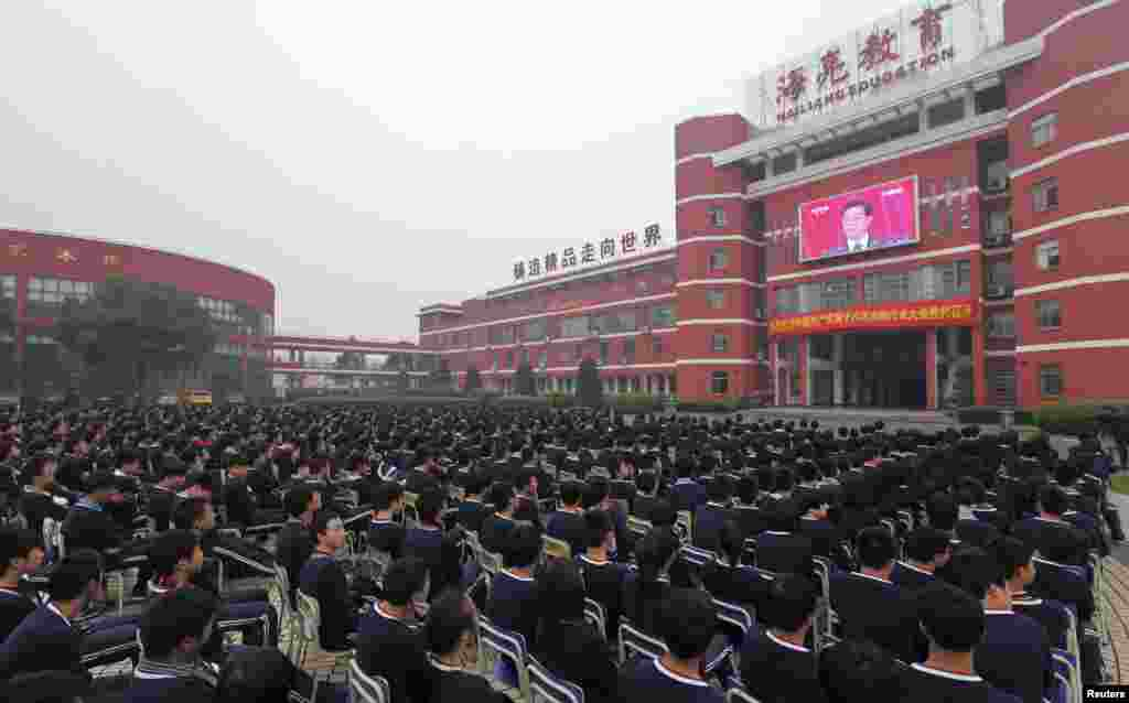 High school students in Zhuji, Zhejiang Province, watch a screen showing Chinese President Hu Jintao delivering the keynote address at the 18th National Congress of the ruling Communist Party in Beijing. (Reuters/China Daily)