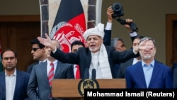 Afghan President Ashraf Ghani speaks during his inauguration in Kabul on March 9.