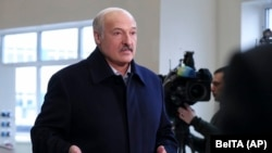 Belarusian President Alyaksandr Lukashenka speaks to journalists as he visits the paper factory in Dobrush on February 4.