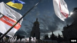 Flags of United Opposition wave above the crowd during their preelection meeting in front of St. Sophia Cathedral in Kyiv on October 26.