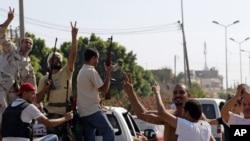 Триполиді басып алған Ливия көтерілісшілерін қолдаушылар.22 тамыз. 2011