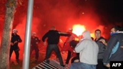 Riot police clash with pro-Serb opposition supporters in Podgorica.