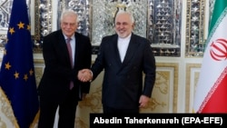 Iranian Foreign Minister Mohammad Javad Zarif (right) meets with EU envoy Josep Borrell at the Foreign Ministry in Tehran on February 3.