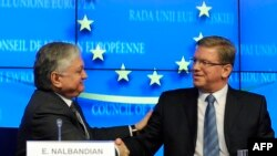 Belgium -- EU Commissioner for Enlargement Stefan Fuele (R) and Armenian Foreign Minister Edward Nalbandian shake hands during a press conference at the EU Headquarters in Brussels, December 9, 2013