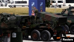 Poland -- Polish soldier prepares a military exhibition in front of the venue of the NATO Summit, which will start in two days, in Warsaw, July 6, 2016