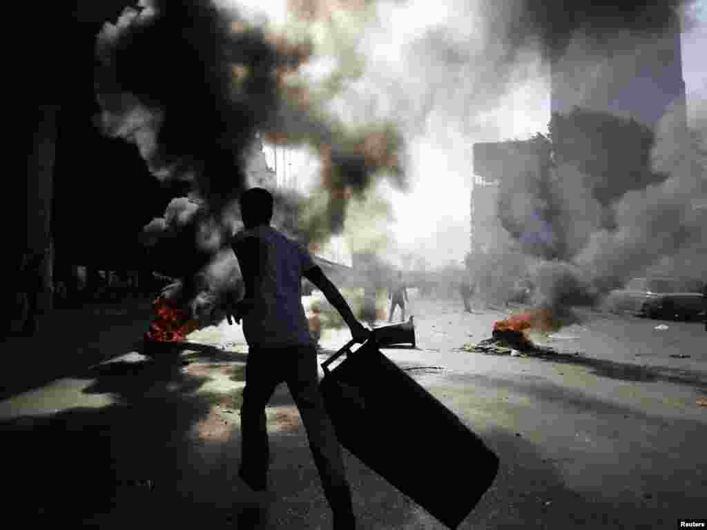 Burning barricades during a demonstration in Cairo on January 28.